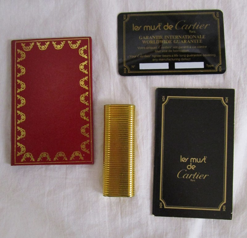 Lot 44 - Cartier 1982 gold plated lighter with guarantee/certificate