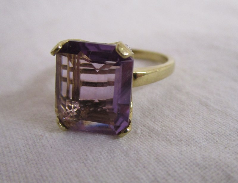 Lot 15 - Gold amethyst & diamond set ring