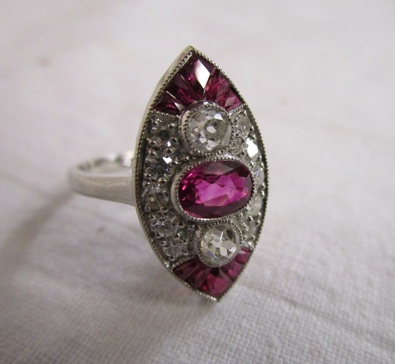 Lot 39 - Platinum ruby & diamond marquee shaped ring