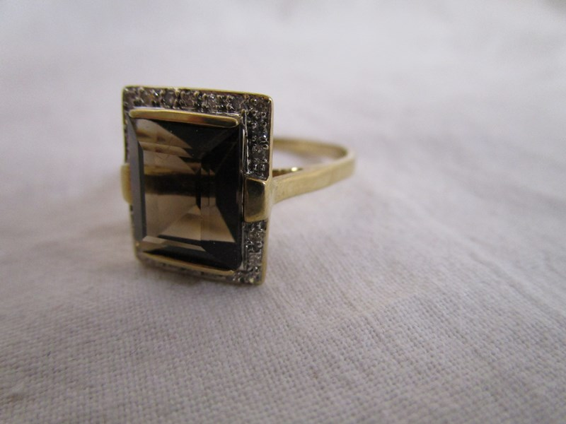 Lot 26 - Gold square cut topaz & diamond ring