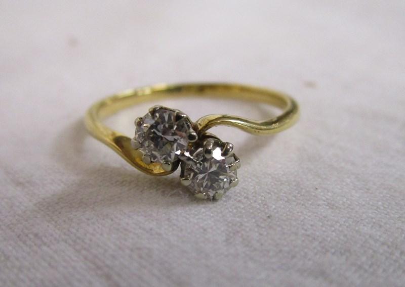 Lot 37 - 18ct gold diamond twist ring