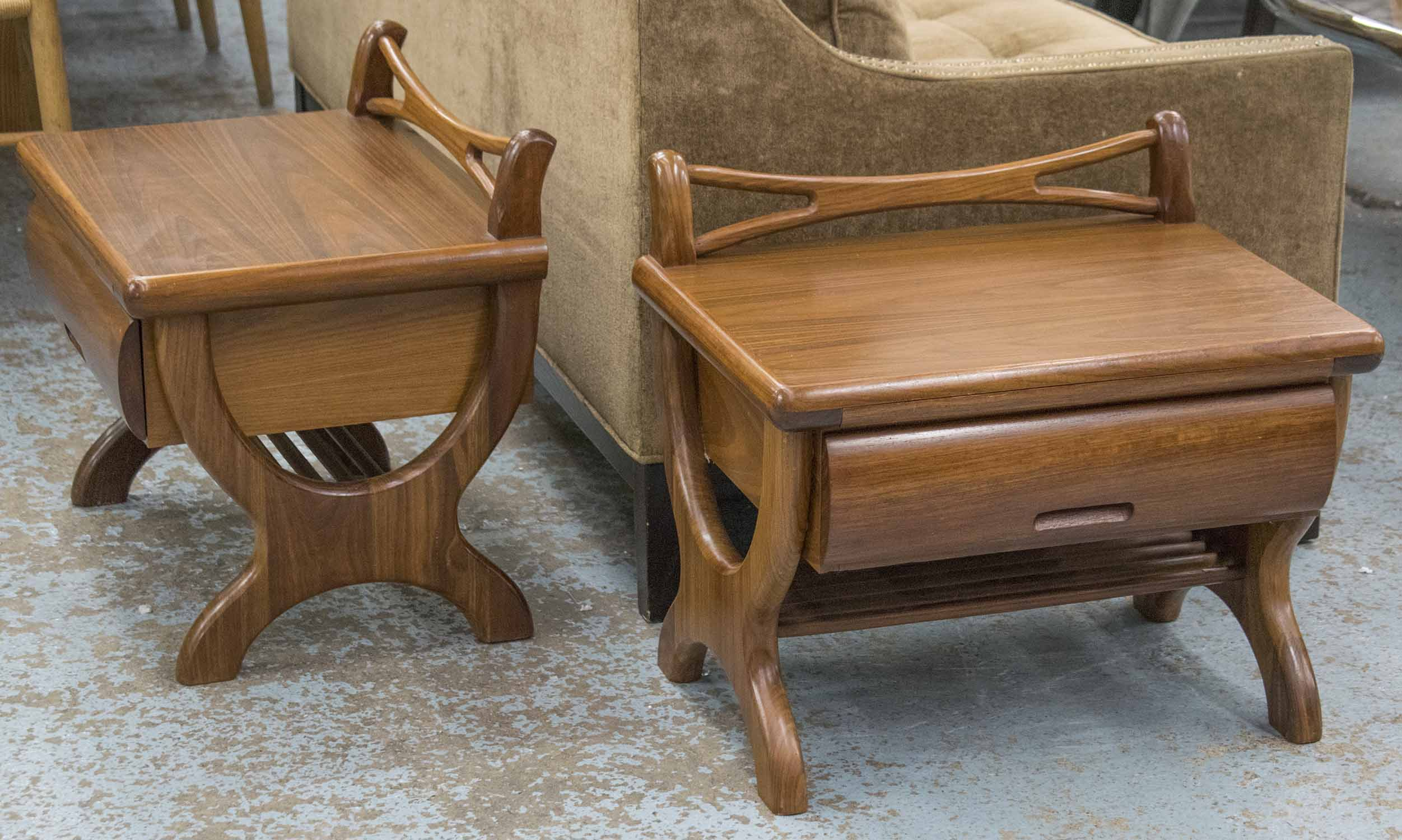 Lot 63 - BEDSIDE TABLES, a pair, teak, each with slide and drawer, 53cm H x 60cm W x 42cm D.