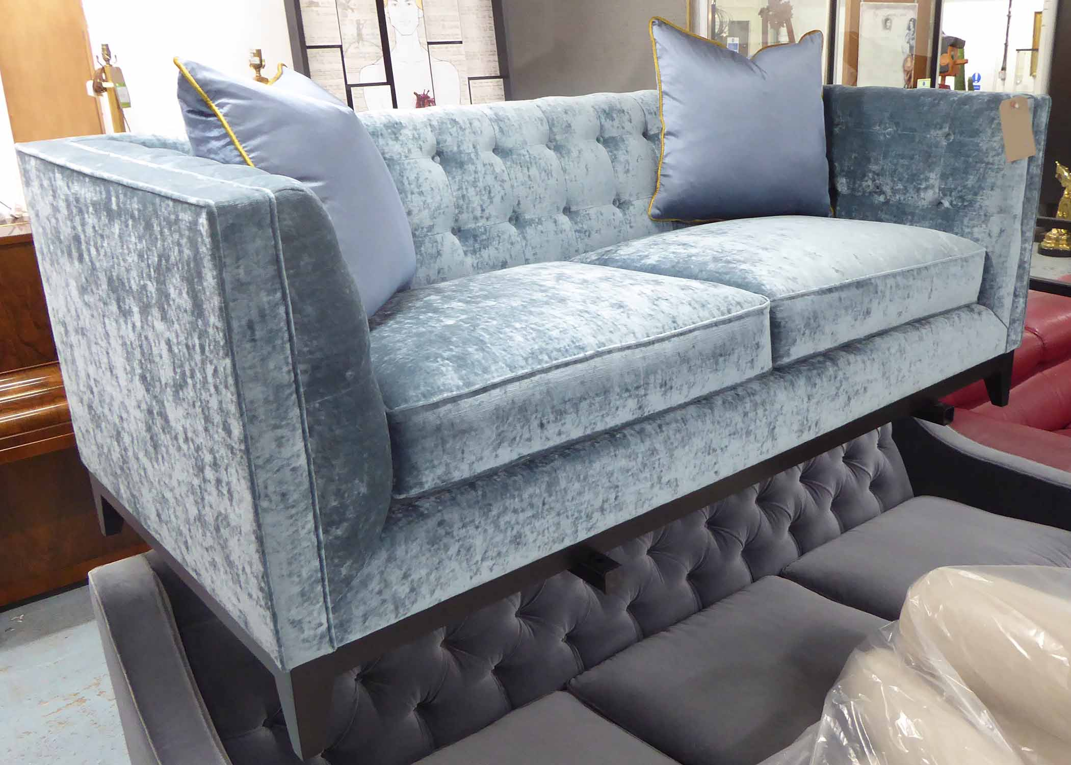 Lot 27 - SOFA, two seater, in a blush button back velvet,