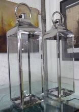 Lot 87 - STORM LANTERNS, a pair, polished metal finish, 80cm H.