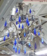 Lot 80 - CHANDELIER, six branch, in a chromed metal frame, with glass drops, 42cm H plus chain.