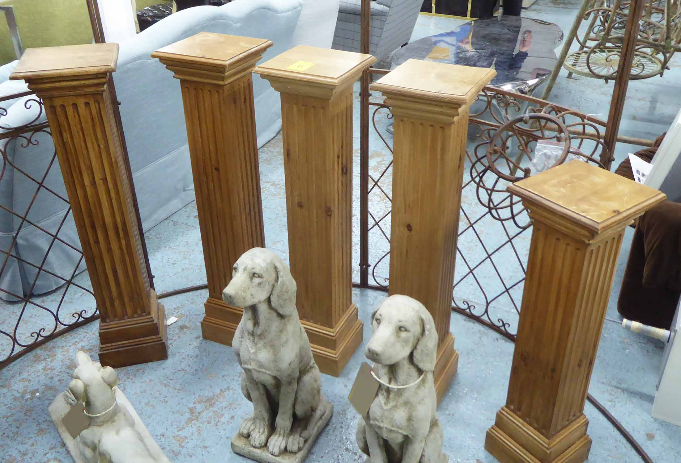 Lot 11 - IONIC COLUMN PEDESTALS, a collection of five, bespoke pine construction, various heights,