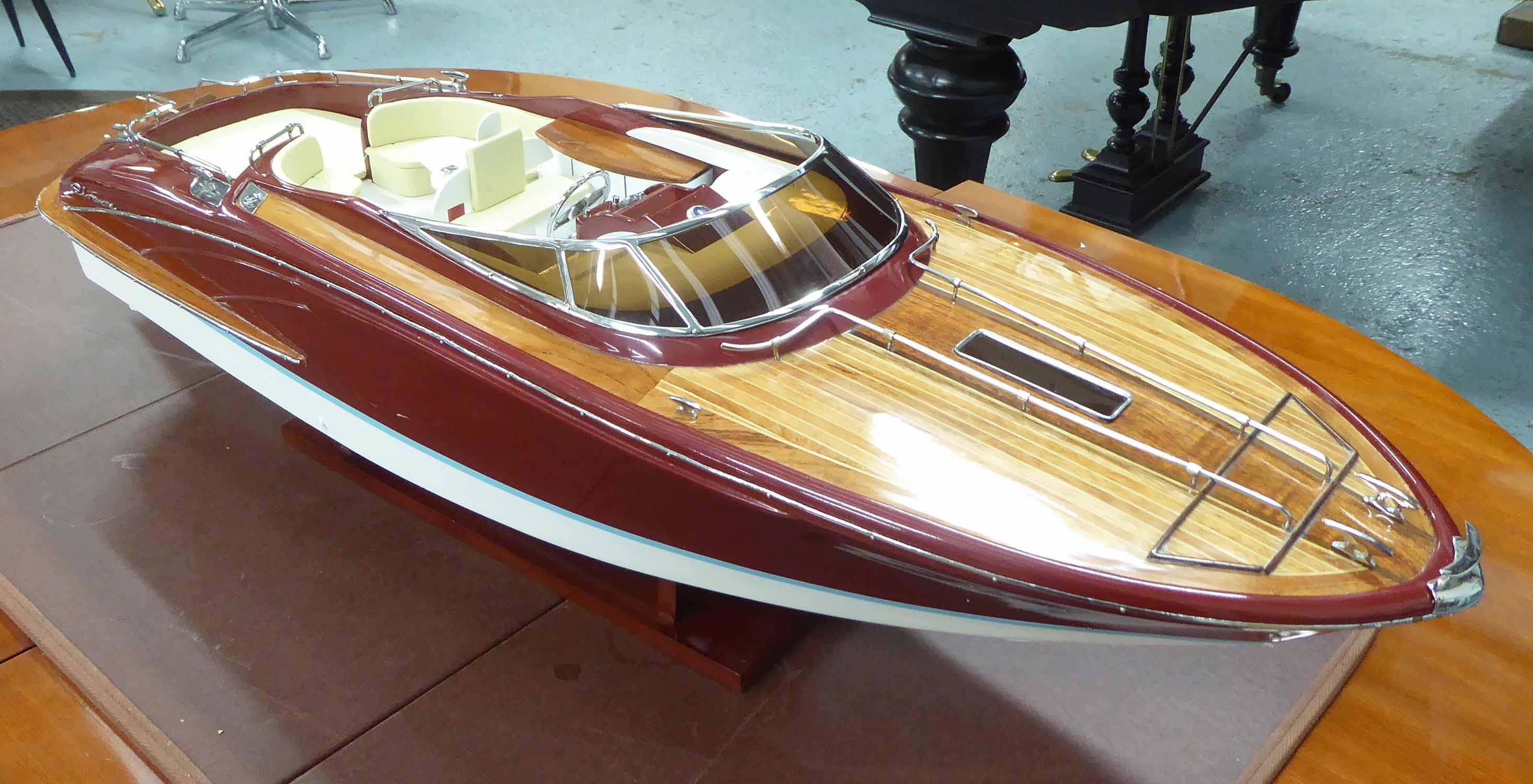 Lot 118 - CLASSIC RIVARAMA MODEL BOAT, lacquer finish, with stand, 90cm L.