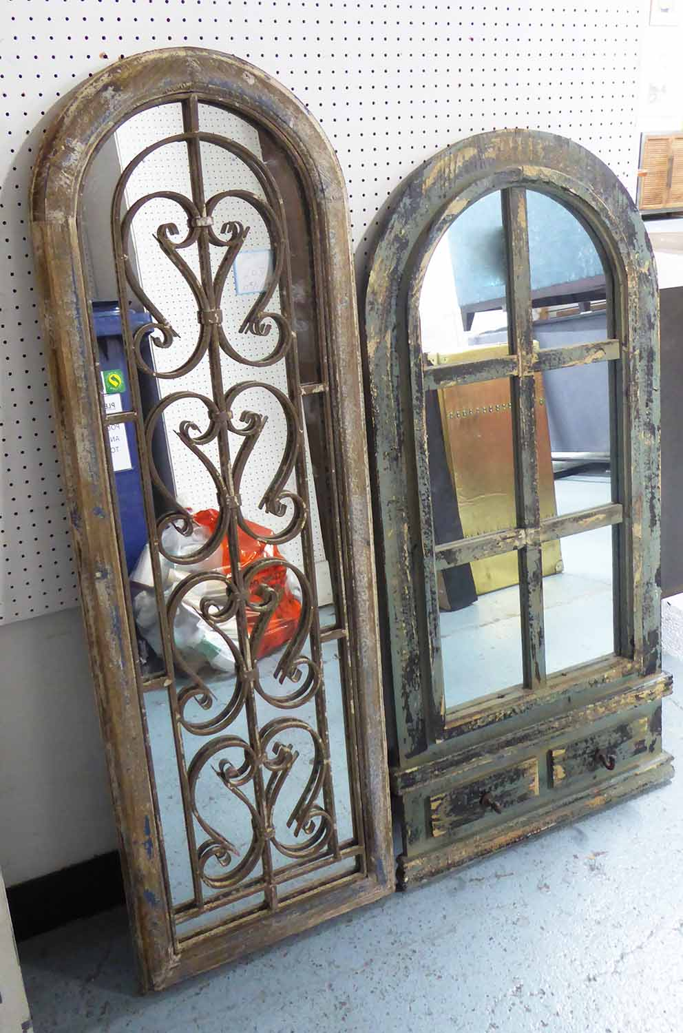Lot 48 - WINDOW MIRRORS, two, both distressed, one with scrolling metal work, the other with coat hooks,