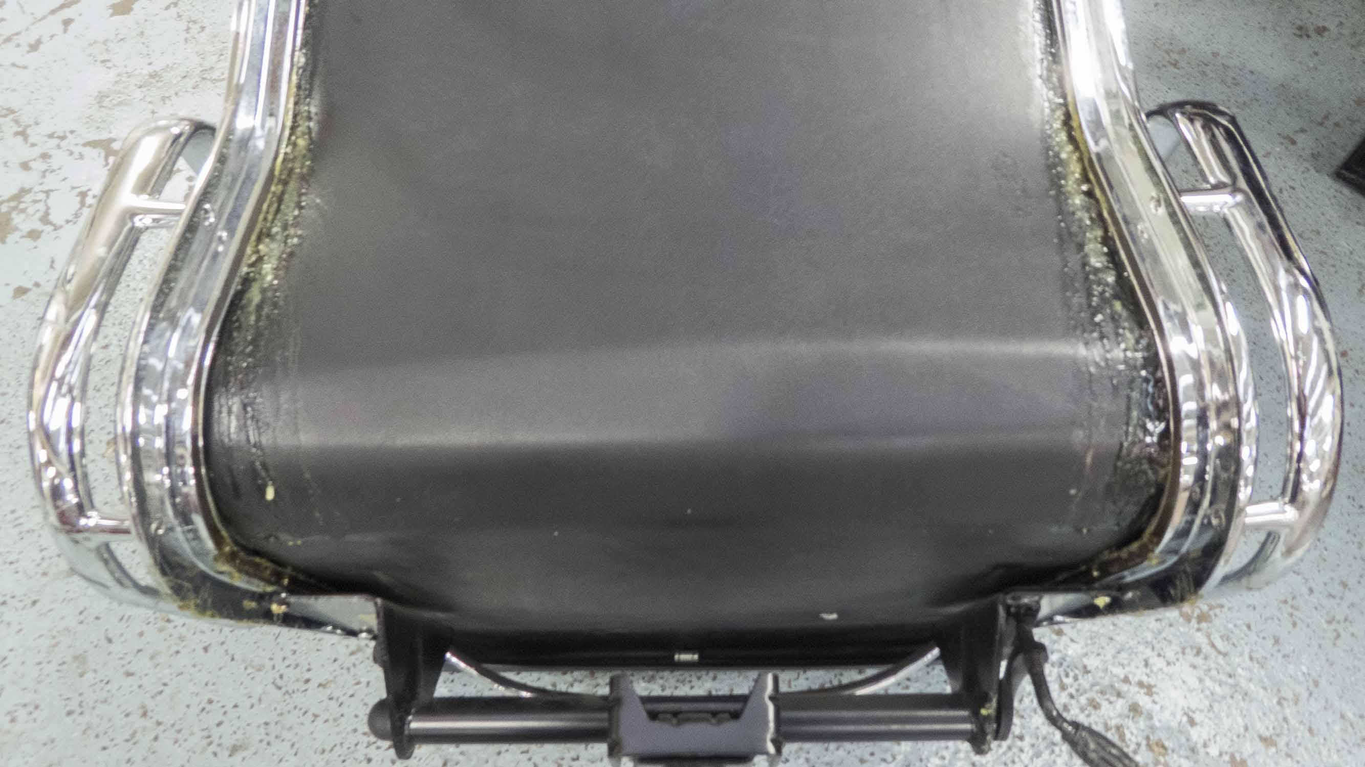 Lot 7 - ICF DESK CHAIR, black leather on chrome frame.