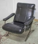 Lot 108 - ARMCHAIR, mid 20th century, in black leatherette on steel supports, 74cm W.