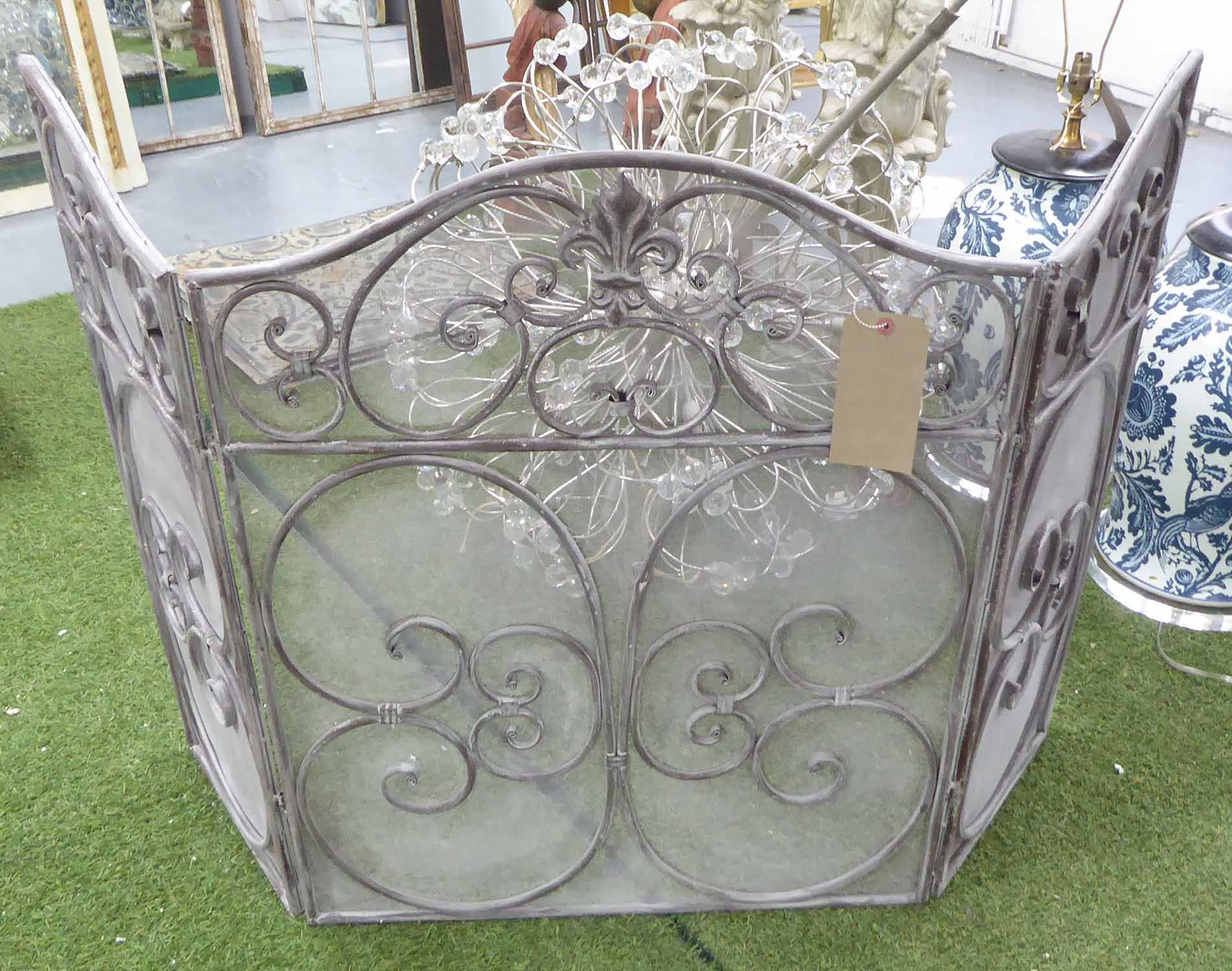 Lot 23 - FIRE SCREEN, in distressed effect metal, folding with three panels, 83cm H.