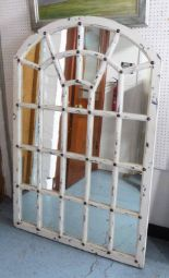 Lot 47 - WINDOW MIRROR, arched, in distressed effect white painted finish with brass studs, 145cm H x 90cm W.