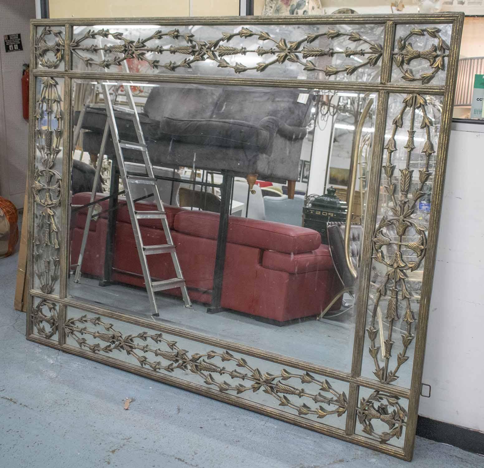 Lot 70 - WALL MIRROR, gilt metal framed with rectangular plate and interweaving bellflower border,