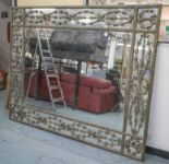 Lot 70 - WALL MIRROR, gilt metal framed with rectangular plate and interweaving bellflower border,