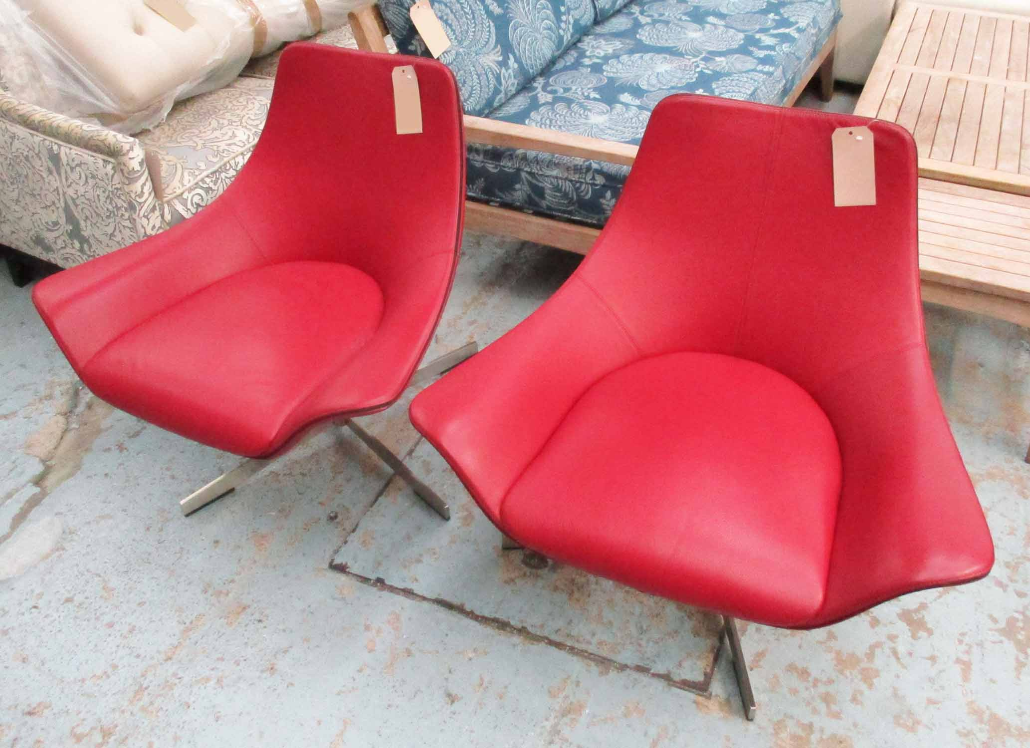 Lot 3 - SWIVEL CHAIRS, a pair, by Matteo Grassi, in burgundy leather, each 87cm x 81cm H.