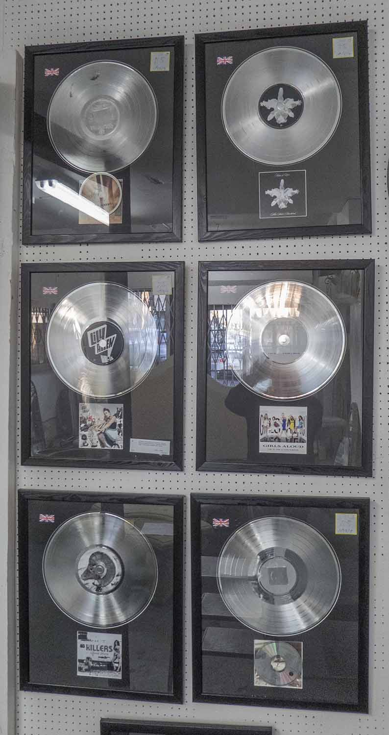 Lot 35 - FRAMED RECORDS, a set of seven, various artists including Girls Aloud, Pink and Kings of Leon.