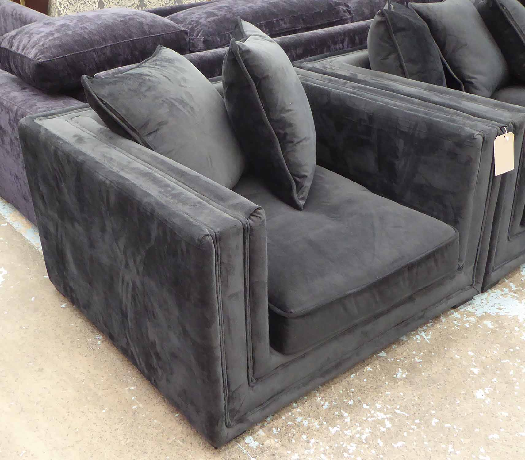 Lot 50 - ARMCHAIR, to match previous lot with two black cushions, 110cm x 64cm H x 103cm.