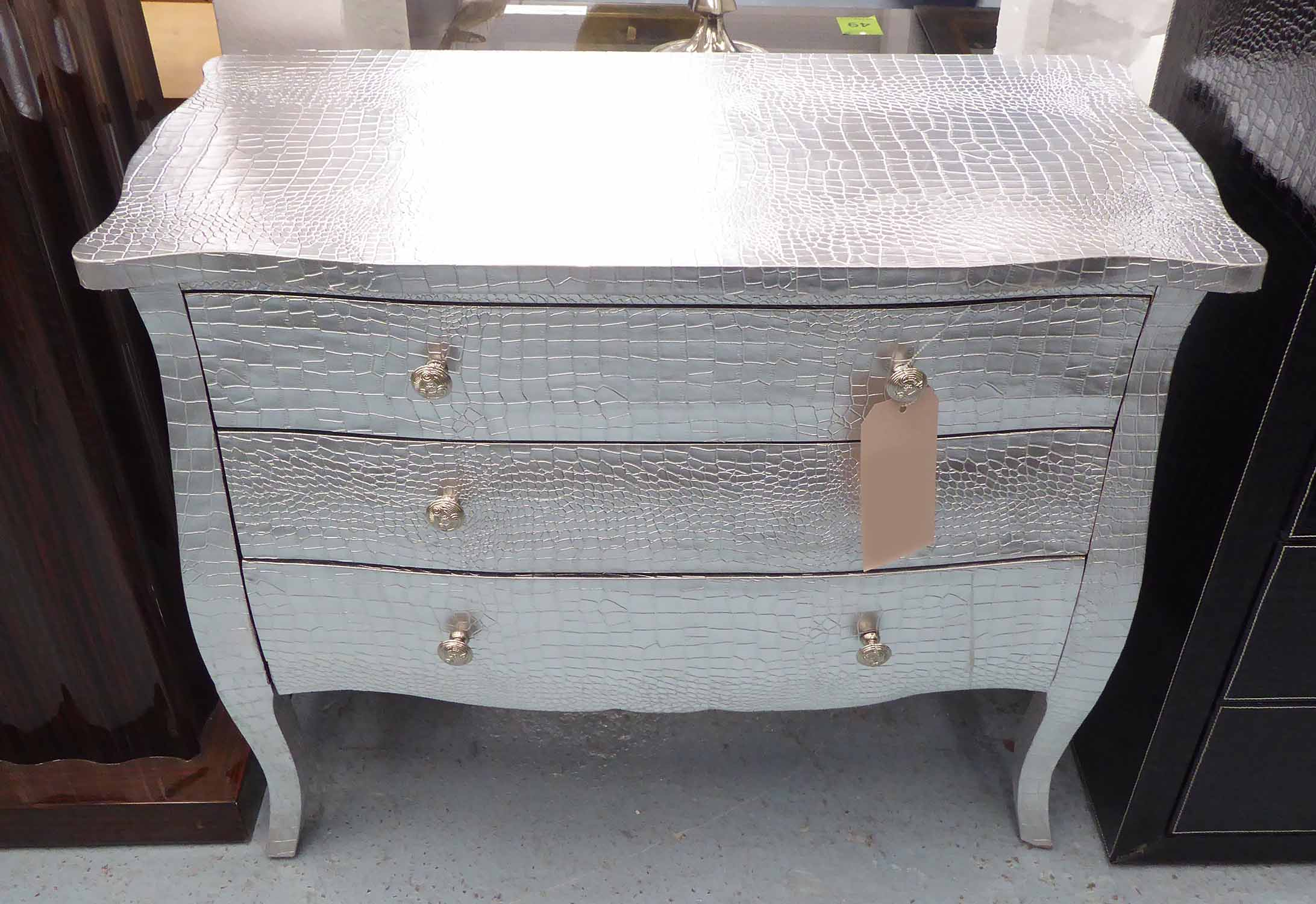 Lot 53 - LOW CHEST, having three long drawers in faux crocodile pattern with silvered finish,