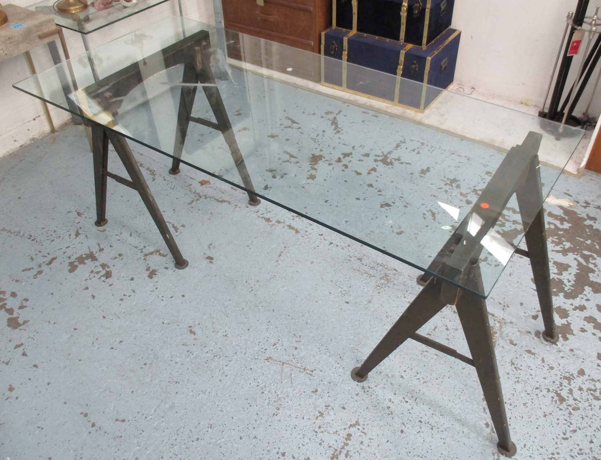 Lot 54 - INDUSTRIAL STYLE DINING TABLE, the glass top on wood and metal painted trestles,