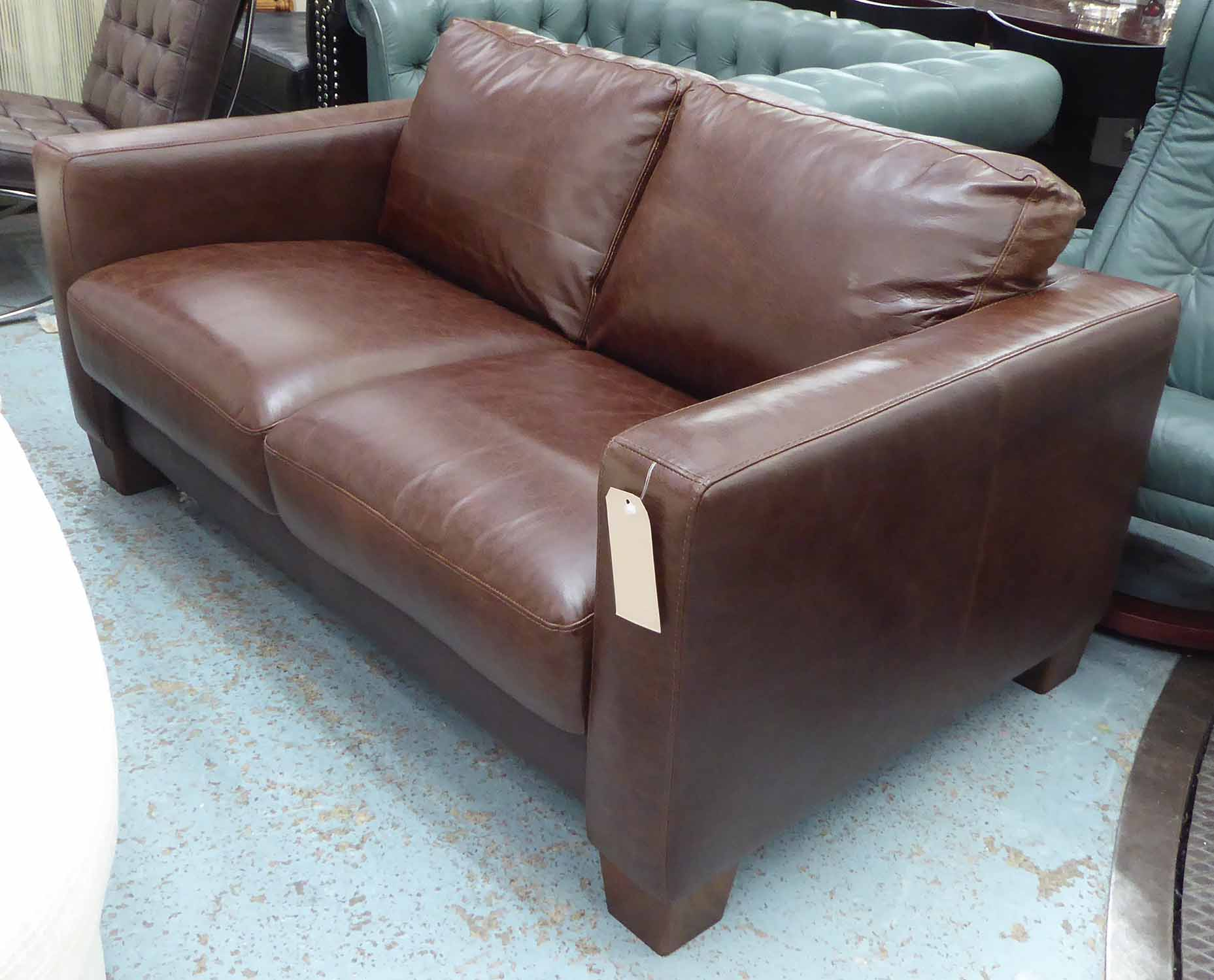 Lot 19 - SOFA, two seater in brown leather, 155cm L x 93cm W x 75cm H.