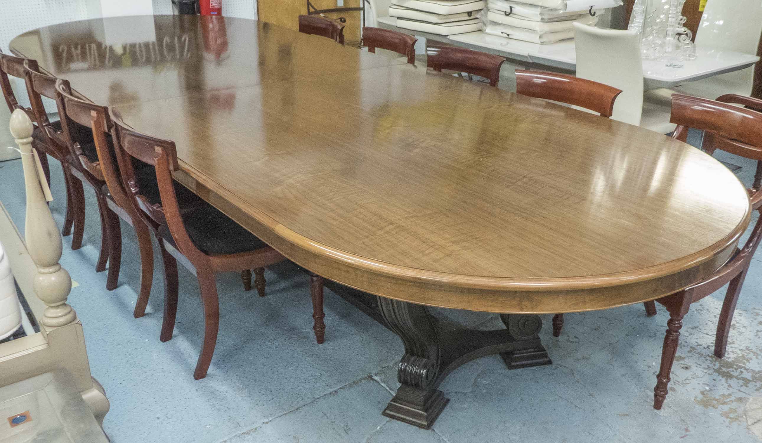 Lot 20 - DINING TABLE, of extra large proportions with an oval top on swept,