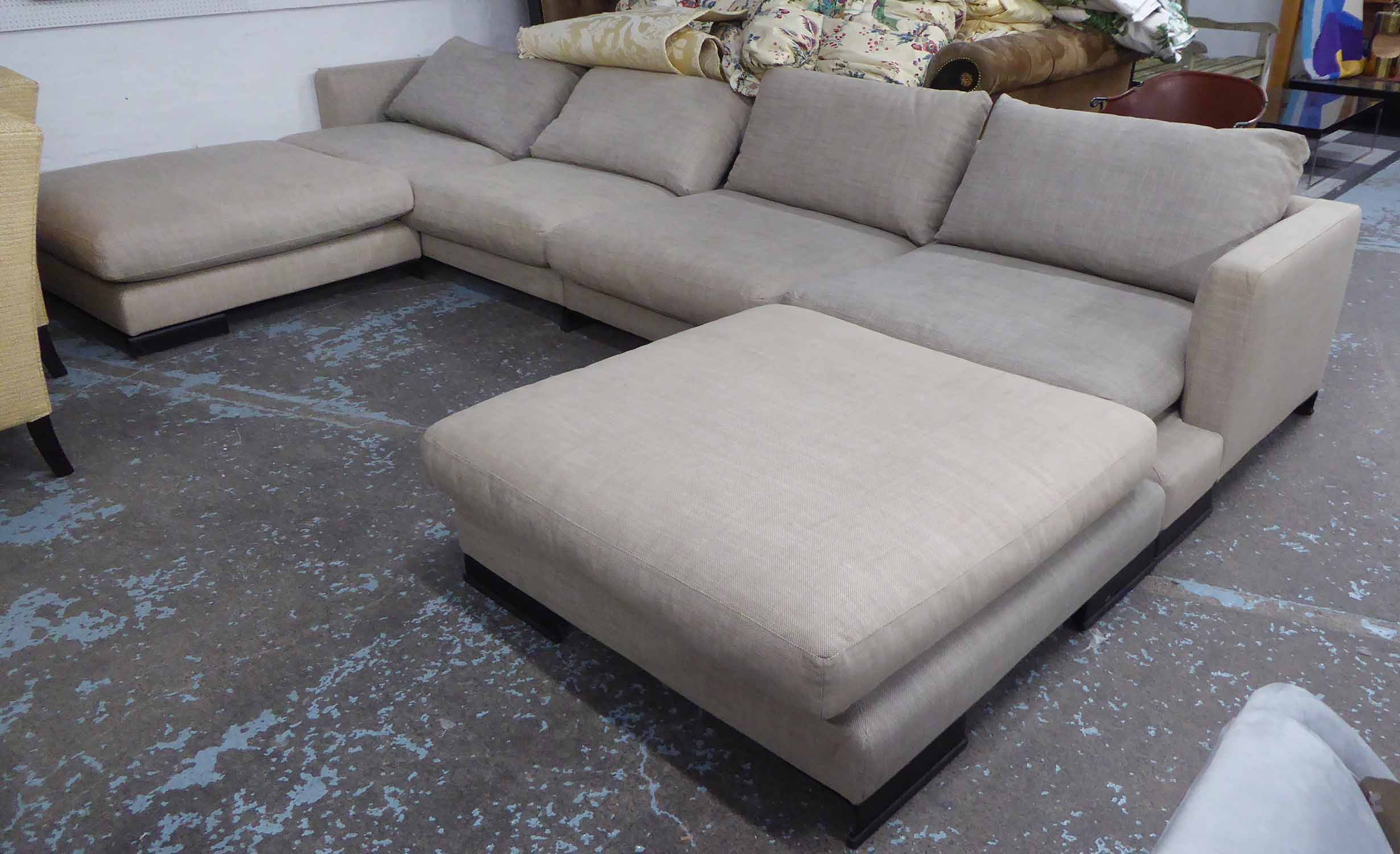Lot 42 - CAMERICH CORNER SOFA, in oatmeal upholstery with two footstools (comes in two parts), 430cm L.