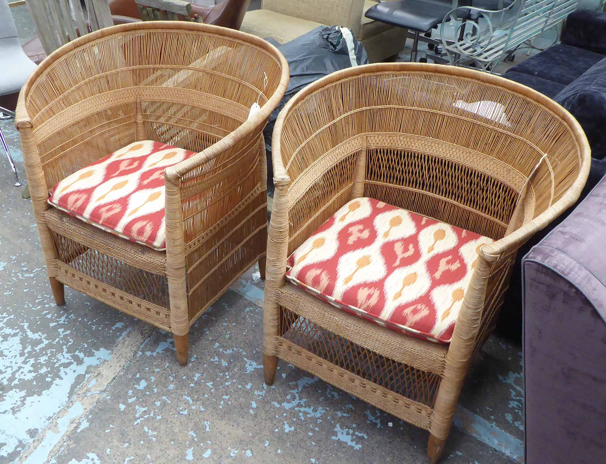 Lot 25 - WICKER ARMCHAIRS, a pair, with Ikat cushioned seats, each 78cm W.