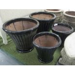 Lot 59 - PLANTERS, two pairs, glazed fluted in black, large 57cm H, small 46cm H.