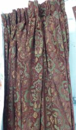 Lot 40 - CURTAINS, a pair, in a brown floral design lined and interlined, each 196cm W gathered x 260cm drop.