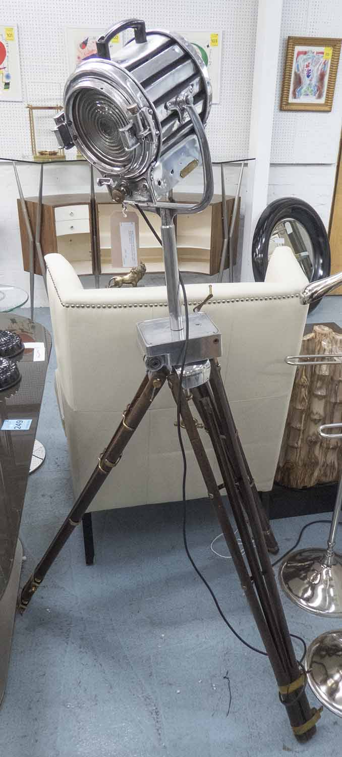 Lot 10 - EARLY 20TH CENTURY SPOTLIGHT, French, in chromed metal with extending wooden tripod supports,