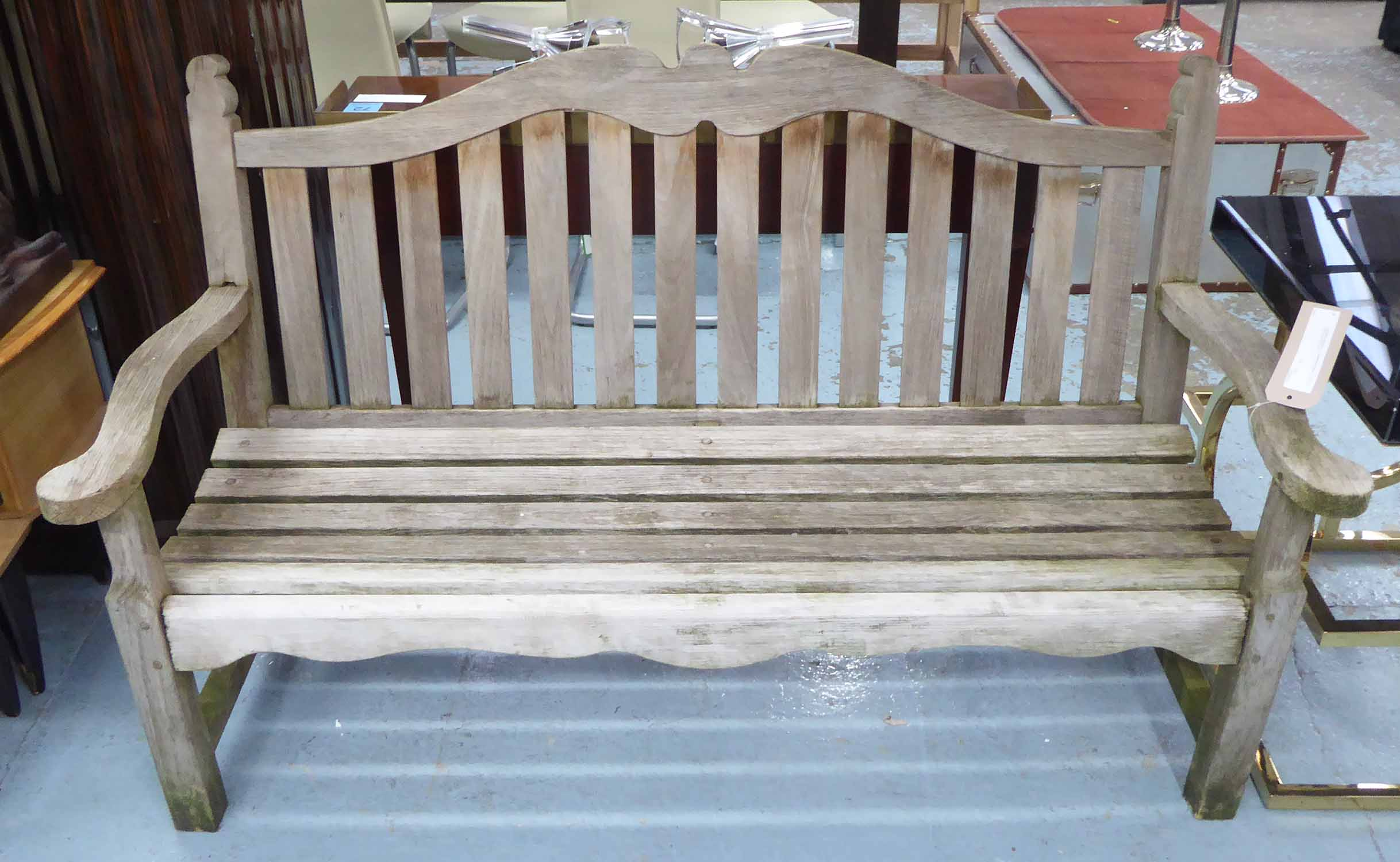 Lot 60 - GARDEN BENCH, in weathered teak, 151cm W x 67cm D x 91cm H.
