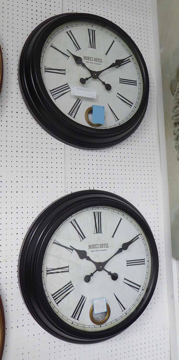 Lot 30 - WALL CLOCKS, a pair, with Roman numerals in a black metal frame, 58cm diam.