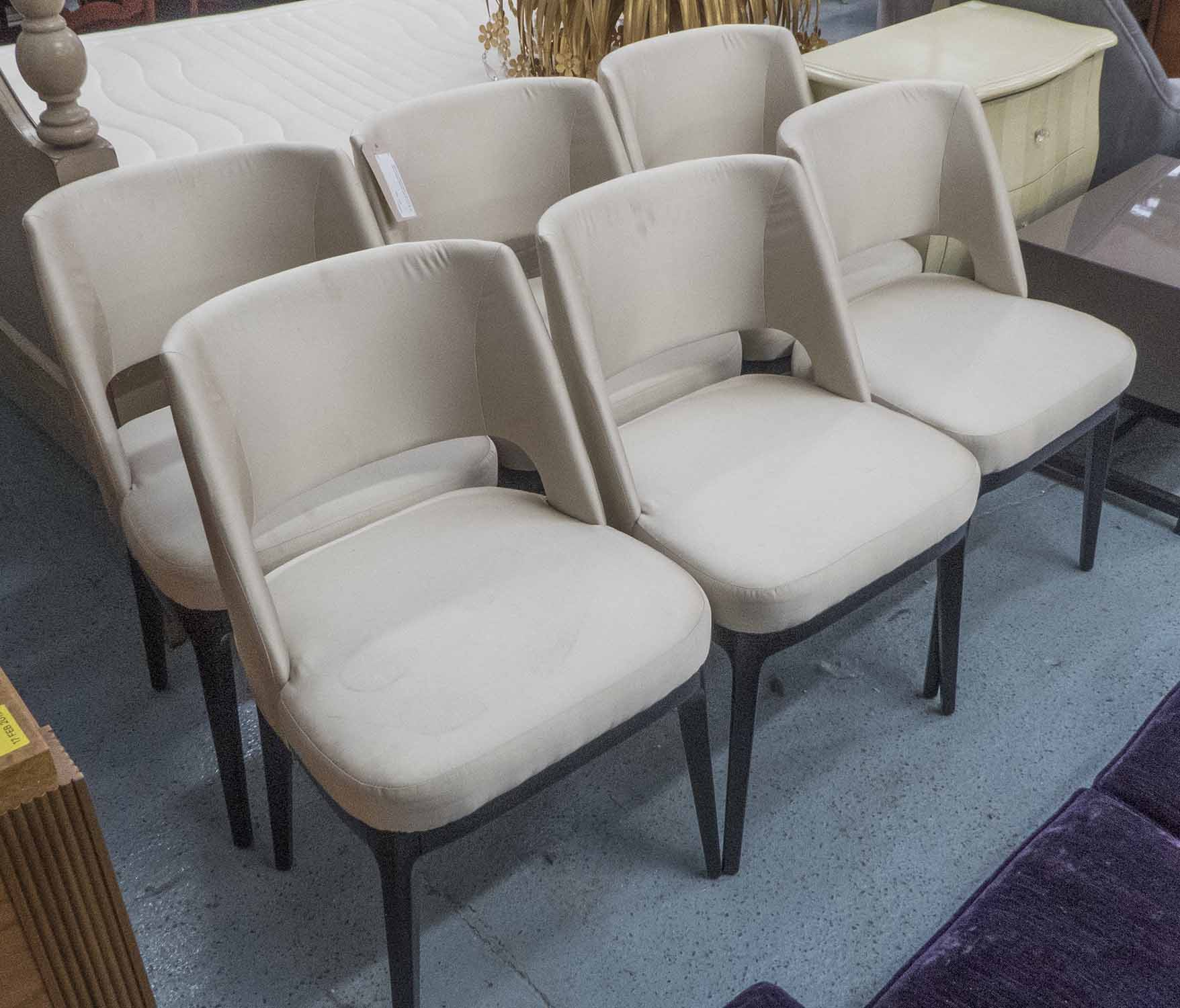 Lot 13 - GRANVILLE DINING CHAIRS, a set of six, in cream on square ebonised supports, 52cm W.