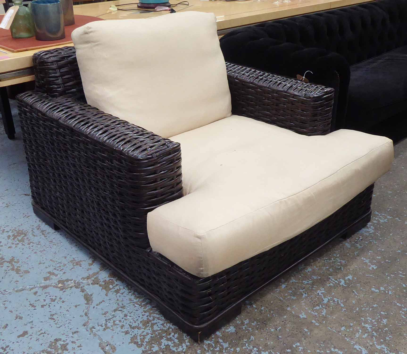 Lot 13 - RALPH LAUREN HOME ARMCHAIR, rattan and ebonised wood with duck down cushions, 110cm W.