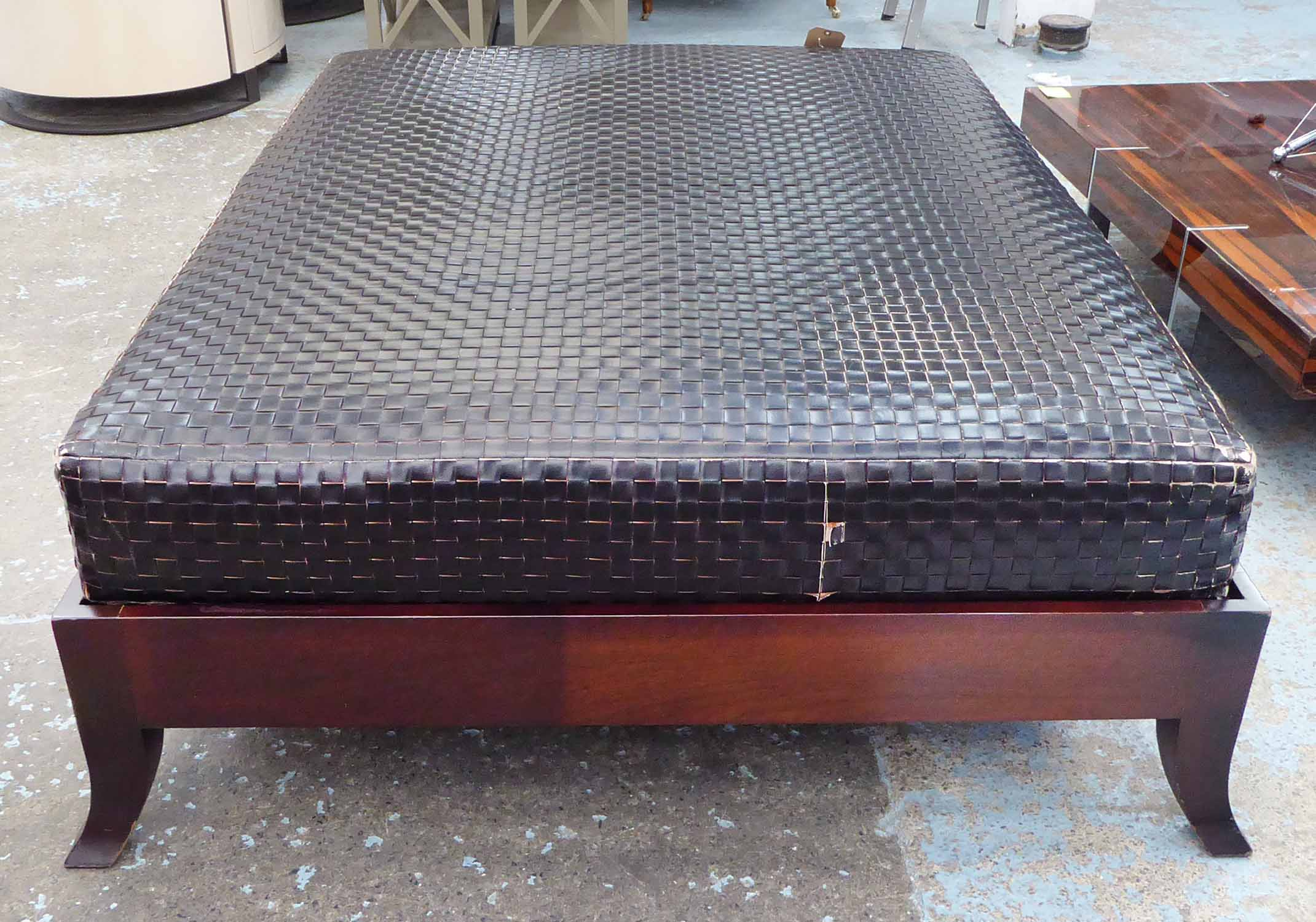 Lot 51 - FOOTSTOOL, of substantial proportions, woven leather top on a wooden base.