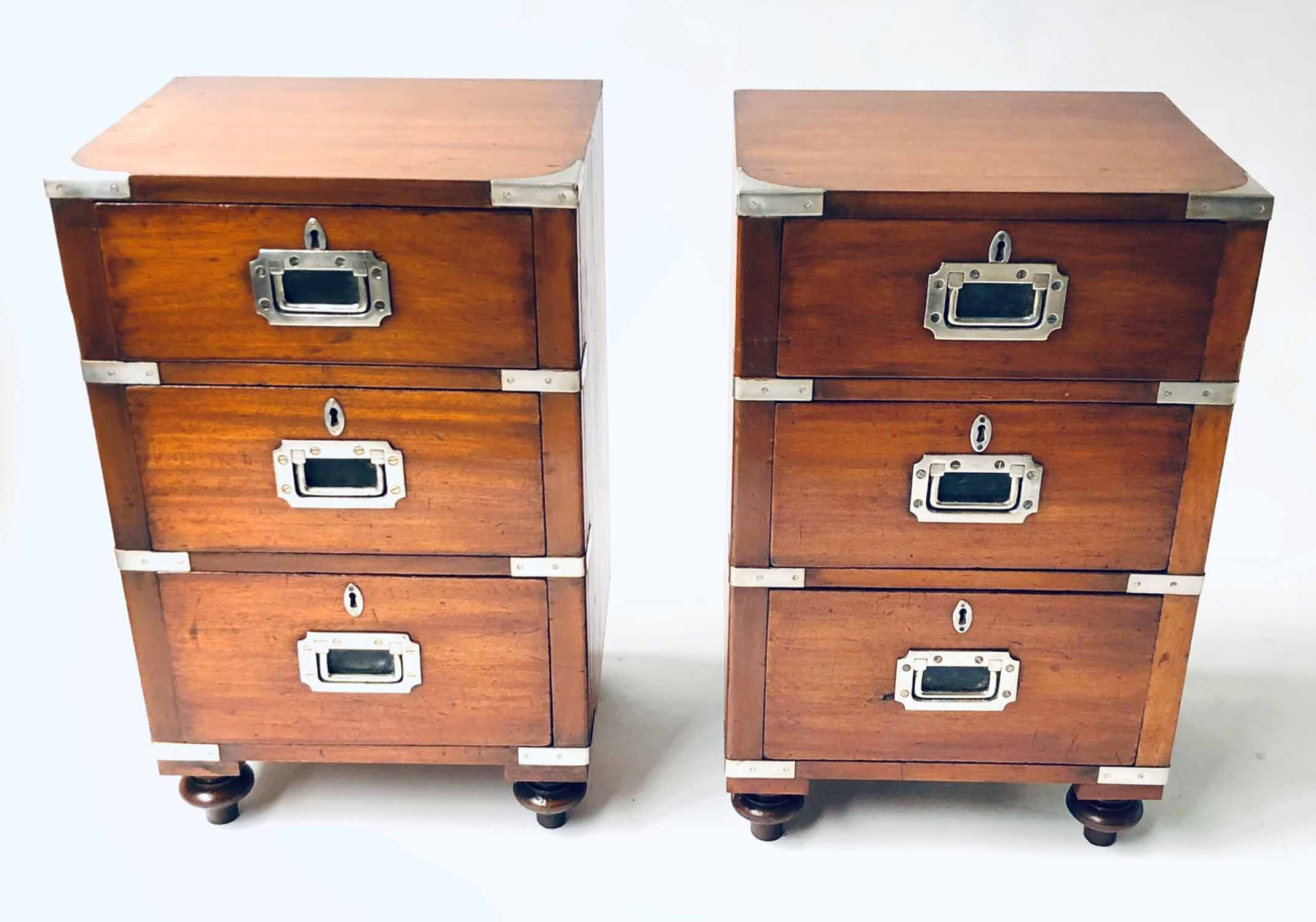 Lot 687 - CAMPAIGN BEDSIDE CHESTS, a pair,