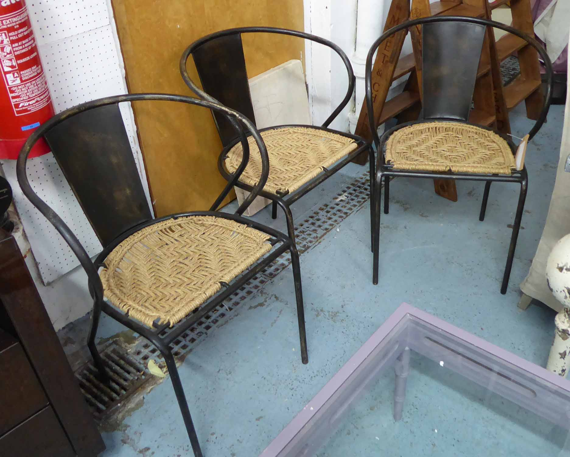 Lot 59 - NUKUKU CHAIRS, a set of three, Industrial metal and wicker dining chairs, 80cm H.