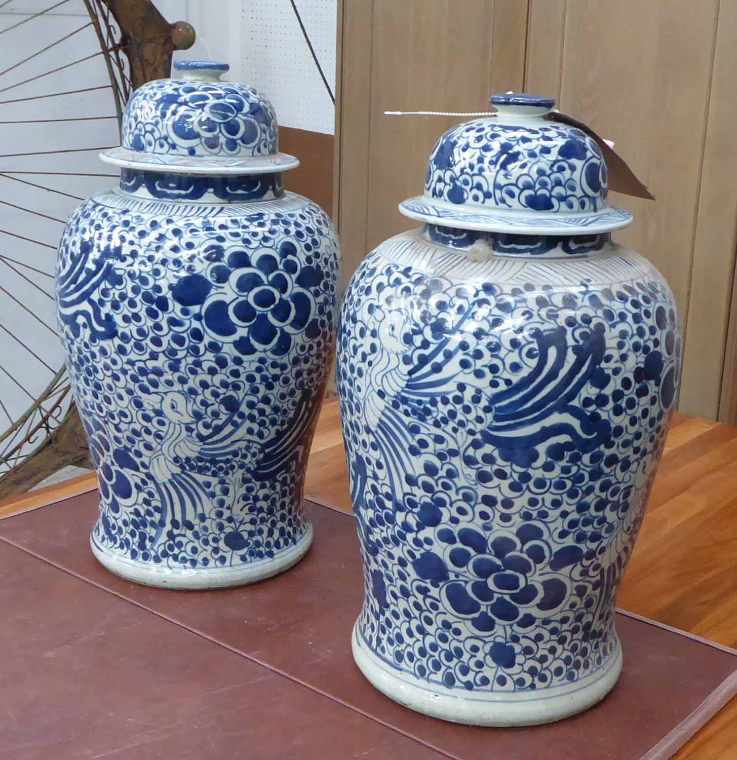 Lot 21 - TEMPLE JARS, a pair, Chinese style blue and white, 47cm H.