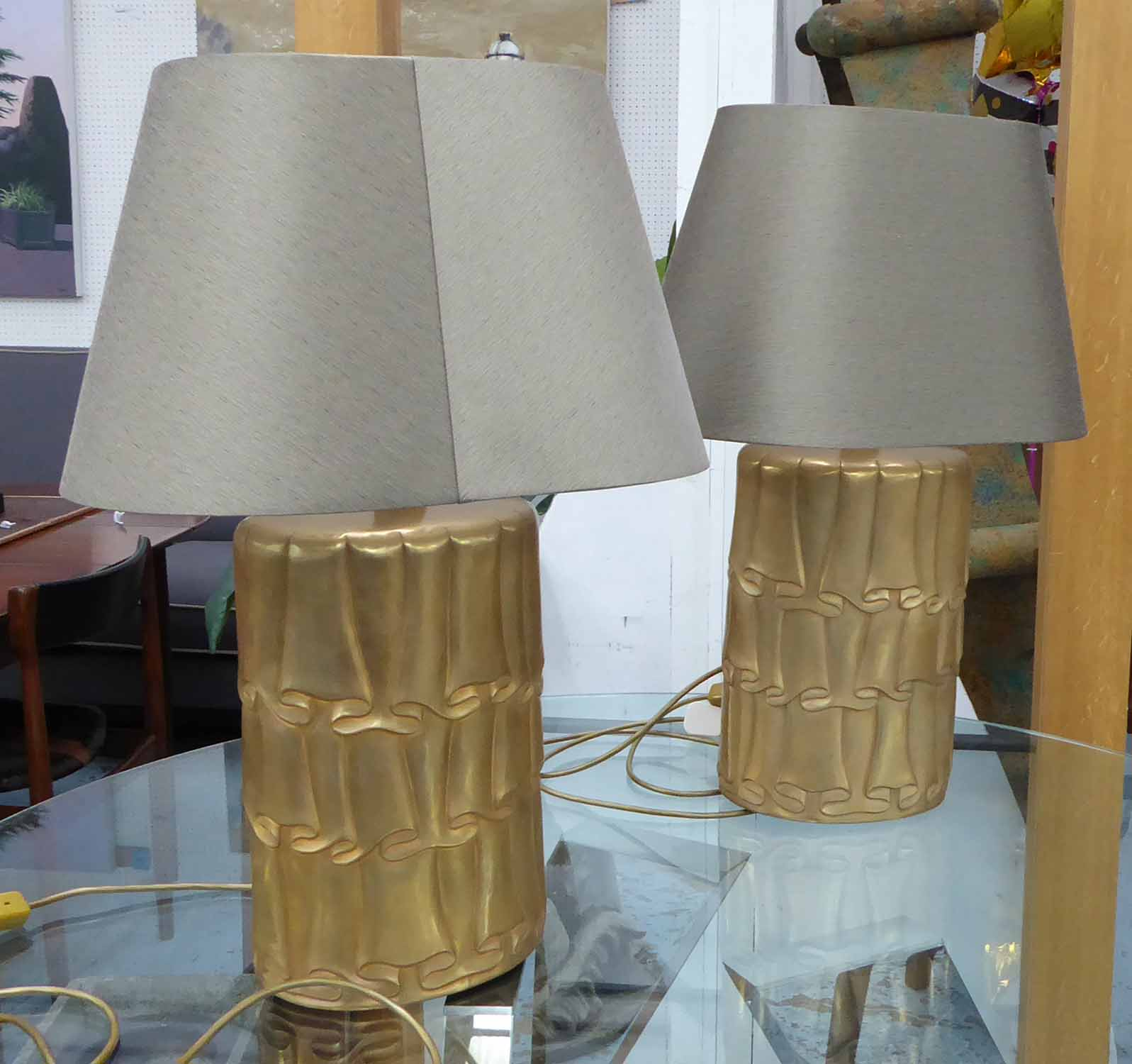 Lot 49 - SIDE LAMPS, a pair, with gilt metal bases with a swagged design, 71cm H including shade.