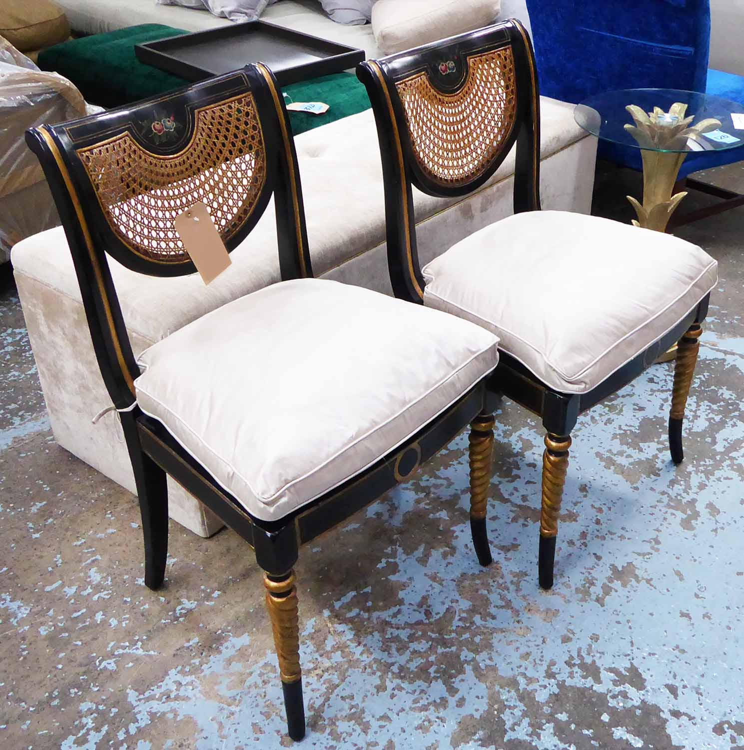 Lot 49 - SIDE CHAIRS, a pair, ebonised with gilt detail, Hollywood regency style, 93cm H.