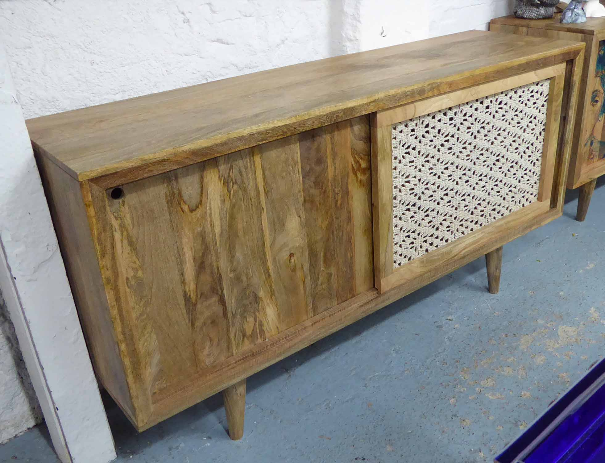 Lot 41 - SIDEBOARD, mango wood, with sliding doors one bound in twine on rounded tapering legs,