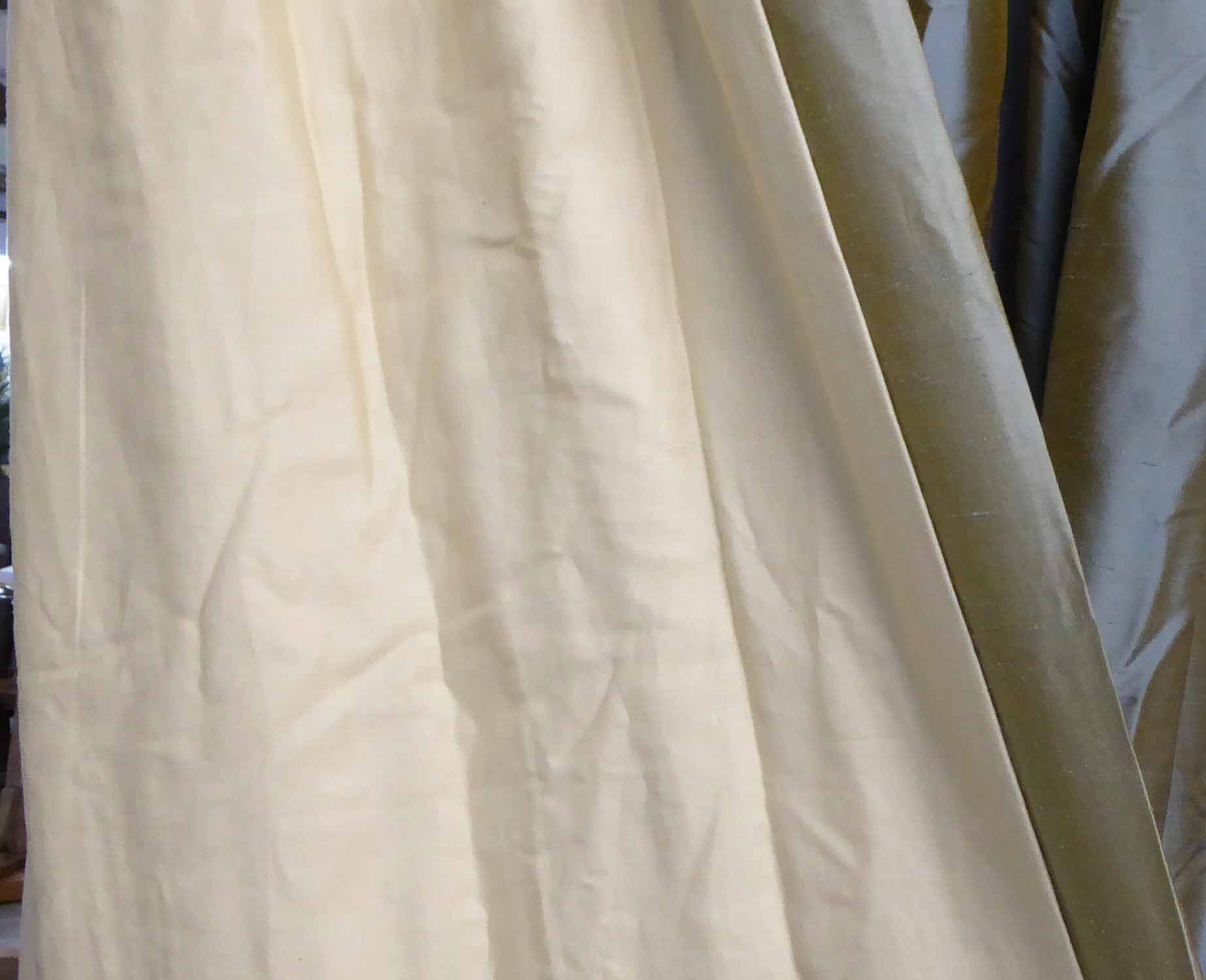 Lot 54 - CURTAINS, two pairs in a blue shimmering silk, lined and interlined,
