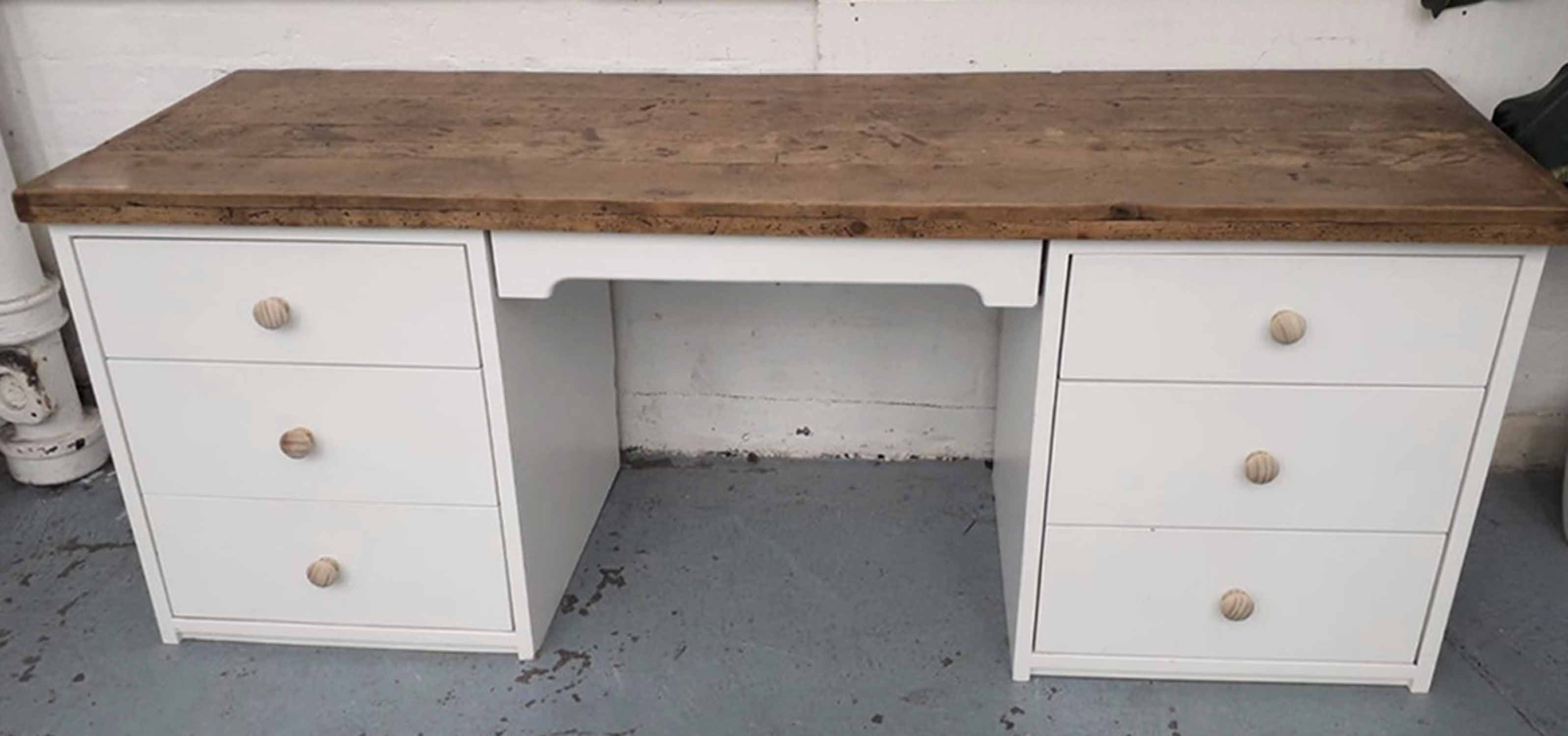 Lot 12 - DESK, with plank rustic top on a white melamine base with seven drawers, 198cm x 60cm x 76cm H.