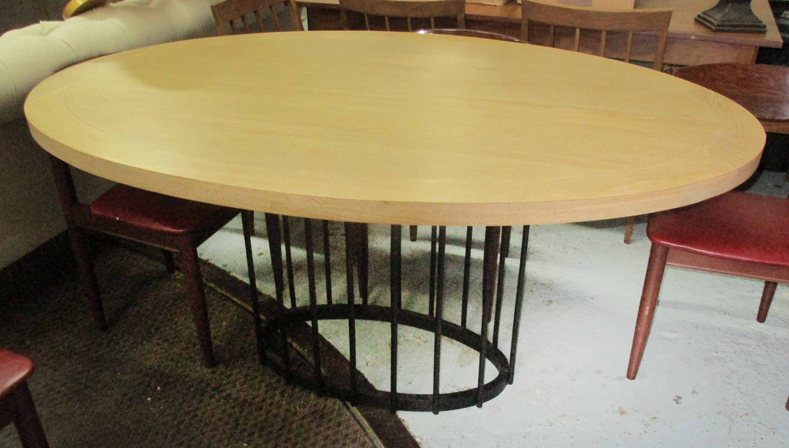Lot 8 - CENTRE TABLE, the oval wooden top on a metal central base, 160cm x 116cm.