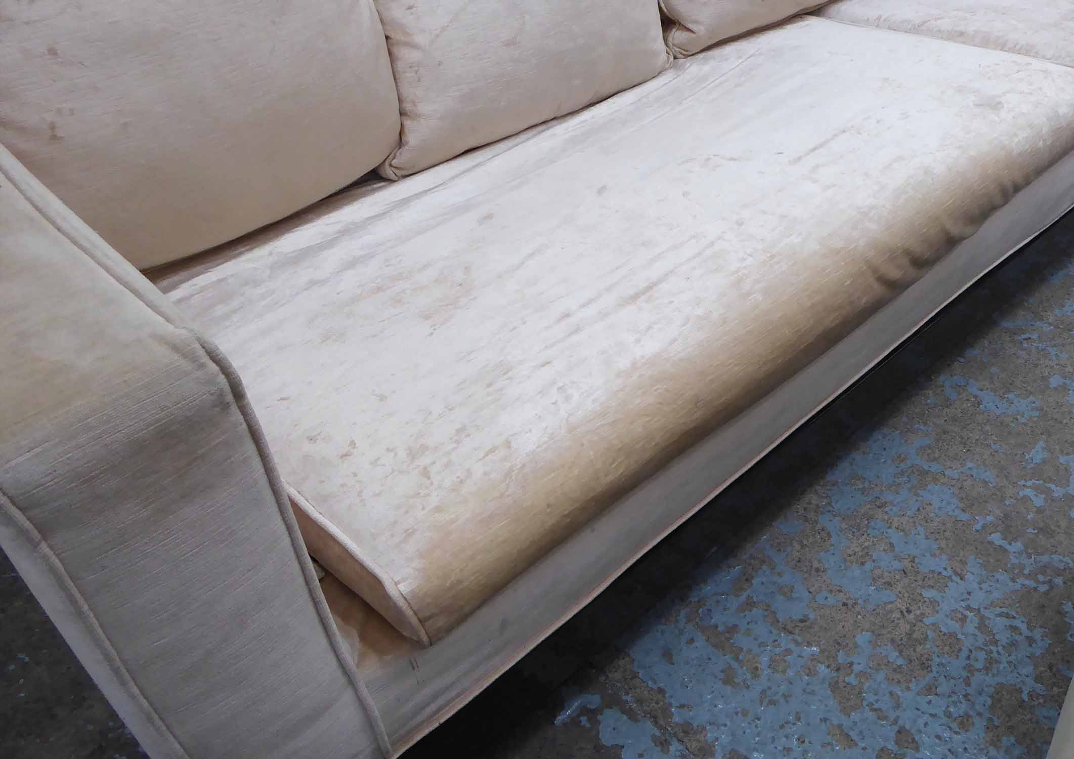 Lot 21 - SOFA, of large proportions in a champagne coloured chenille on an exotic wood plinth,