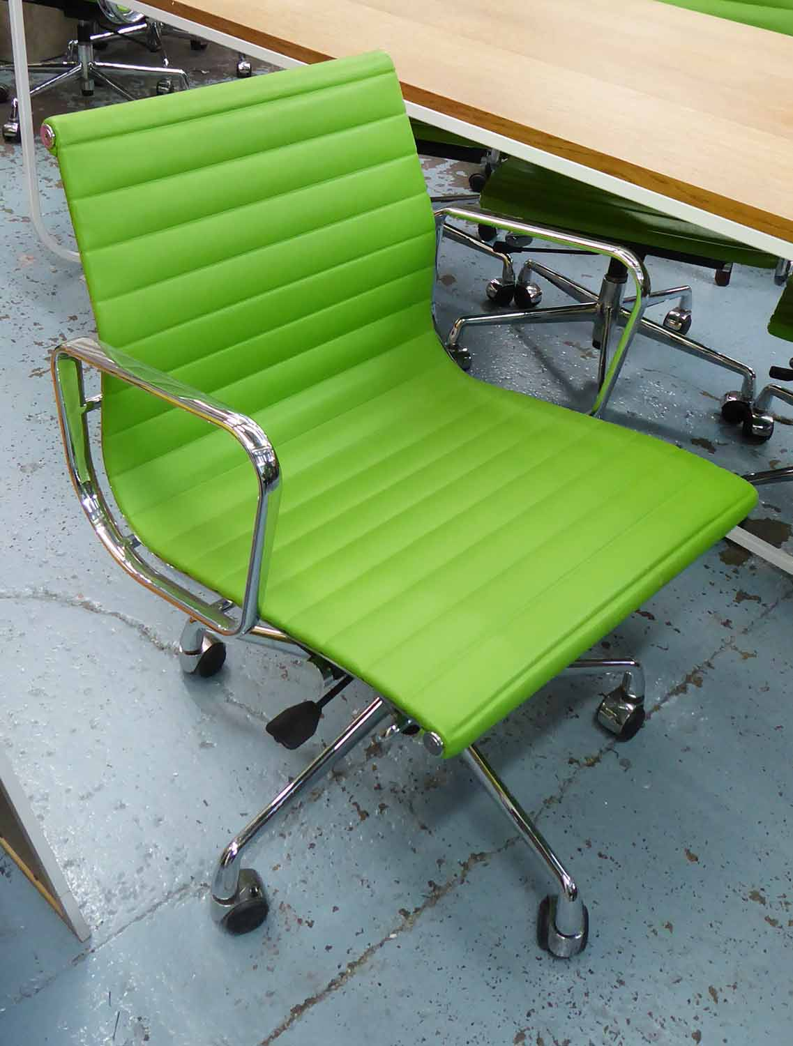 Lot 18 - AFTER CHARLES & RAY EAMES ALUMINIUM GROUP STYLE DESK CHAIR, 91cm H x 57cm W.