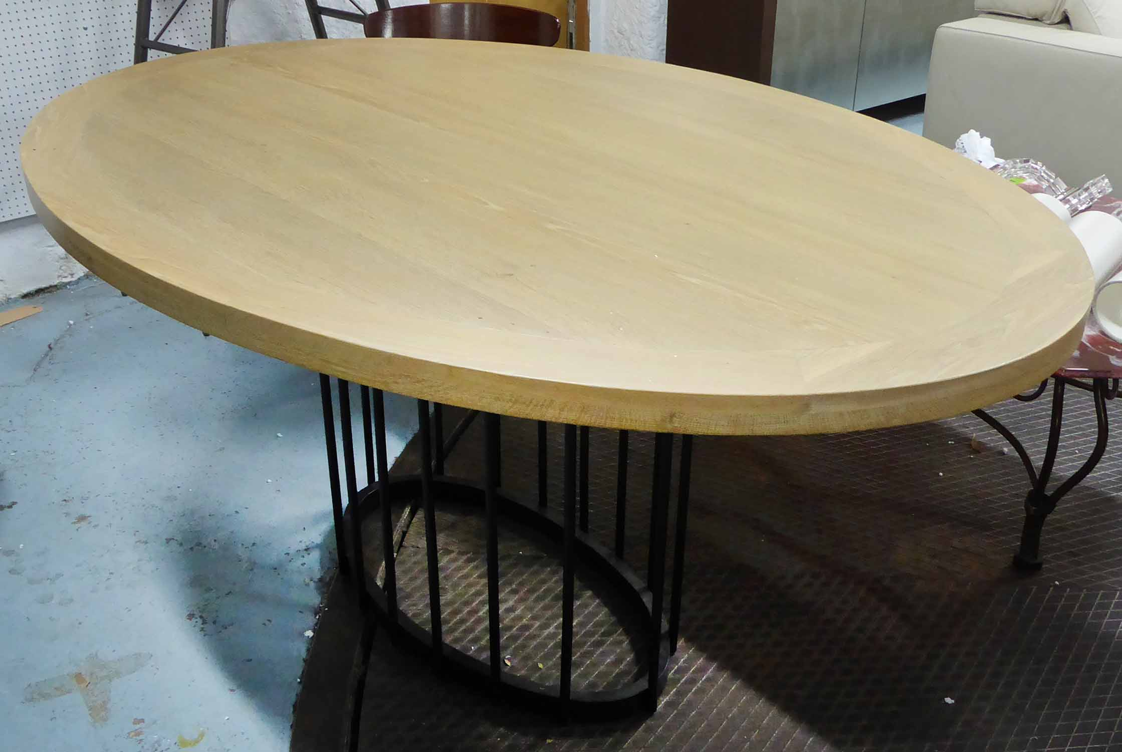 Lot 58 - CENTRE TABLE, the oval wooden top on a metal central base, 160cm x 116cm.