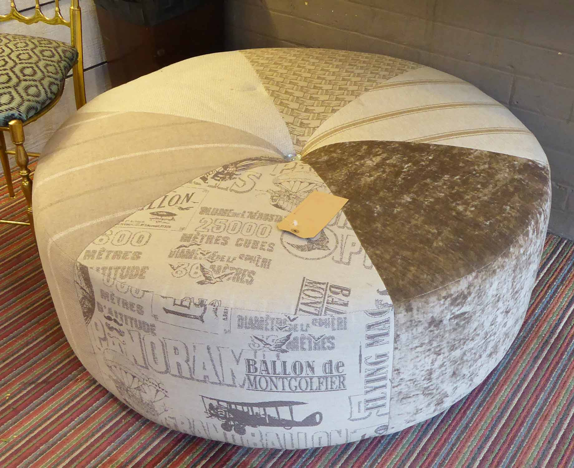 Lot 59 - OTTOMAN, contemporary in Voyages inspired fabric, 100cm diam x 40cm.