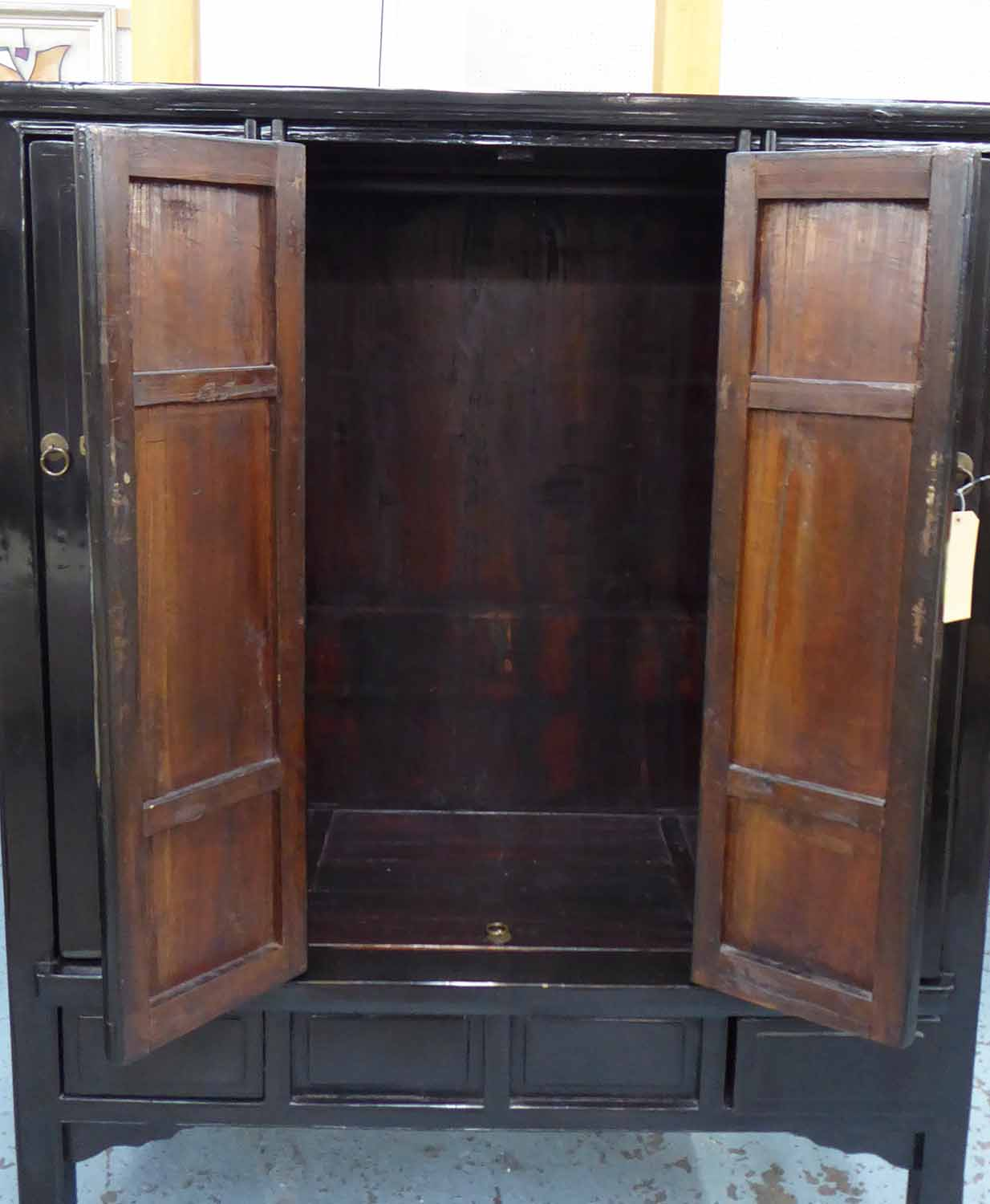 Lot 37 - CHINESE MARRIAGE CABINET, black wood with sand character decoration, 130cm x 162cm H x 56cm.