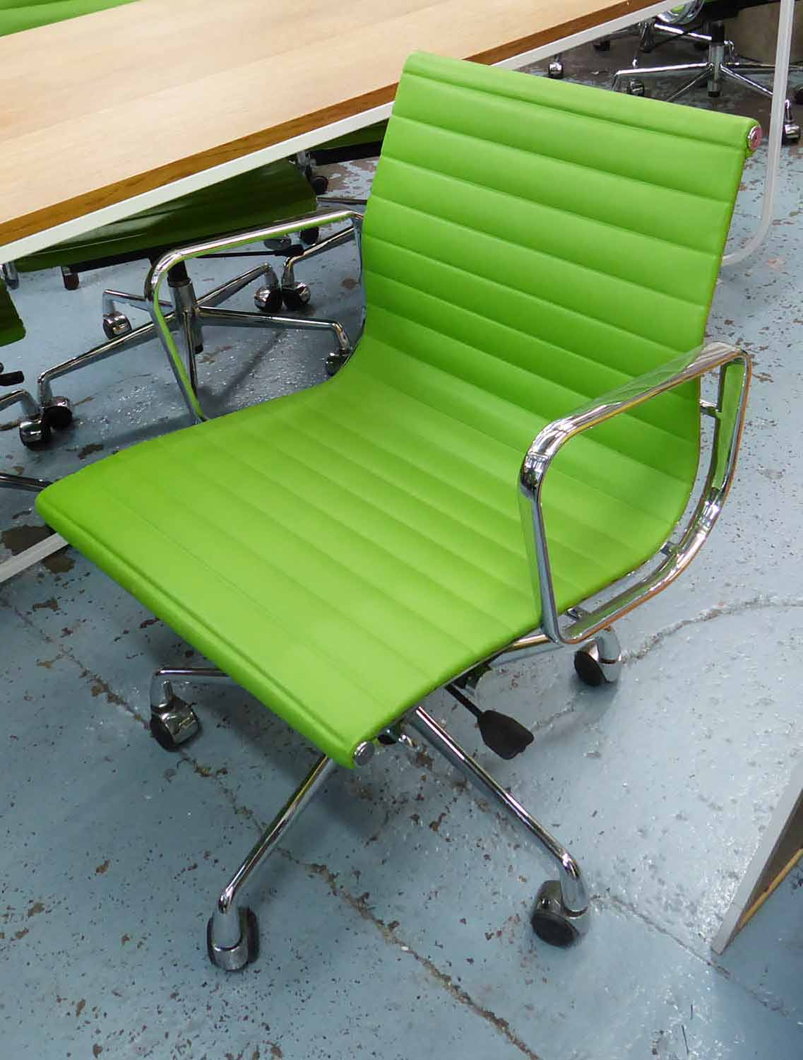 Lot 17 - AFTER CHARLES & RAY EAMES ALUMINIUM GROUP STYLE DESK CHAIR, 91cm H x 57cm W.